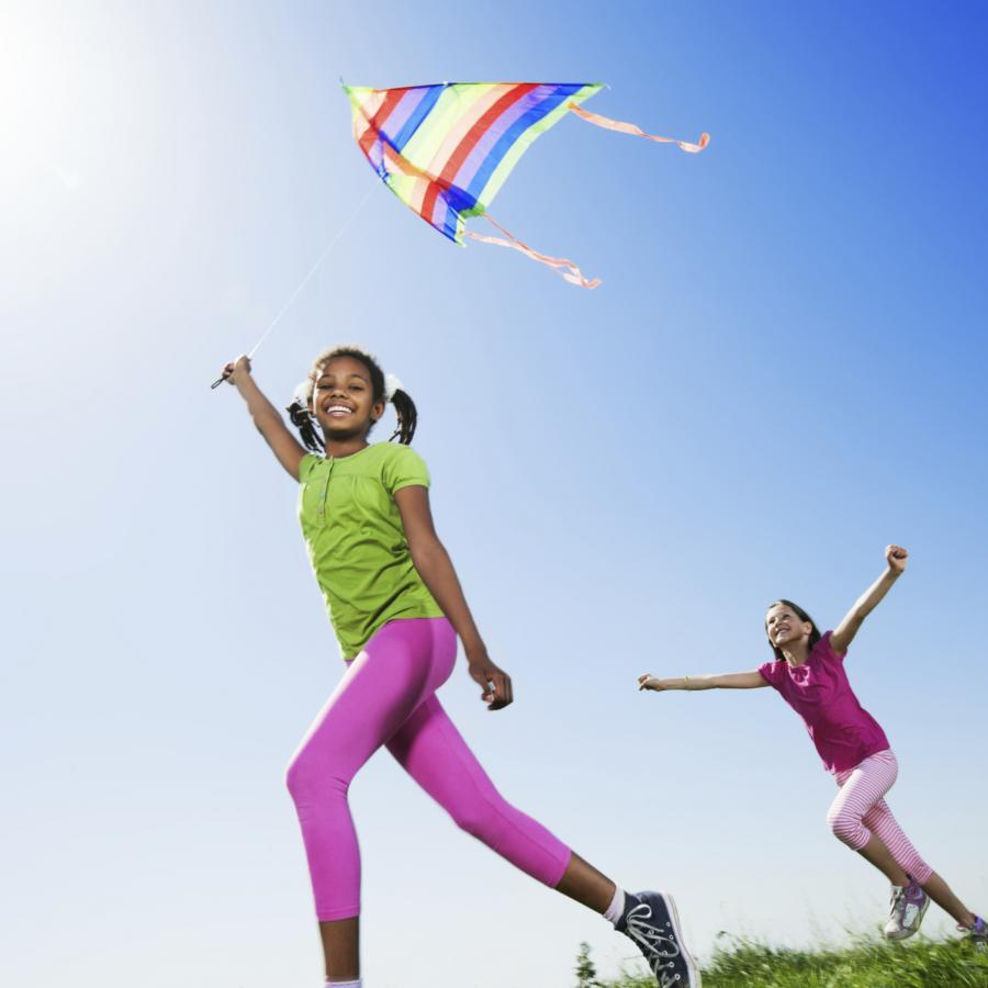 girl-waving-kite