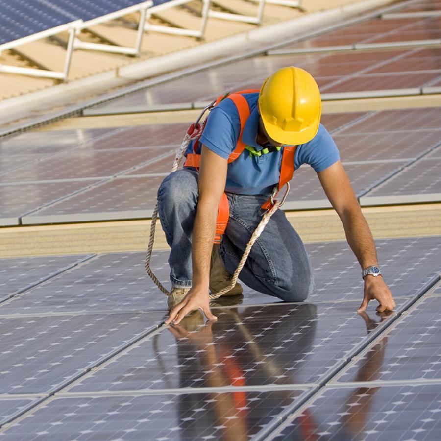 man-installing-solar-panels