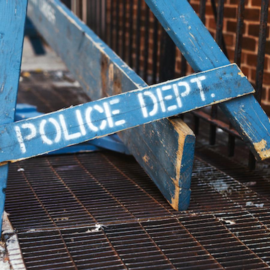 broken-police-barracade